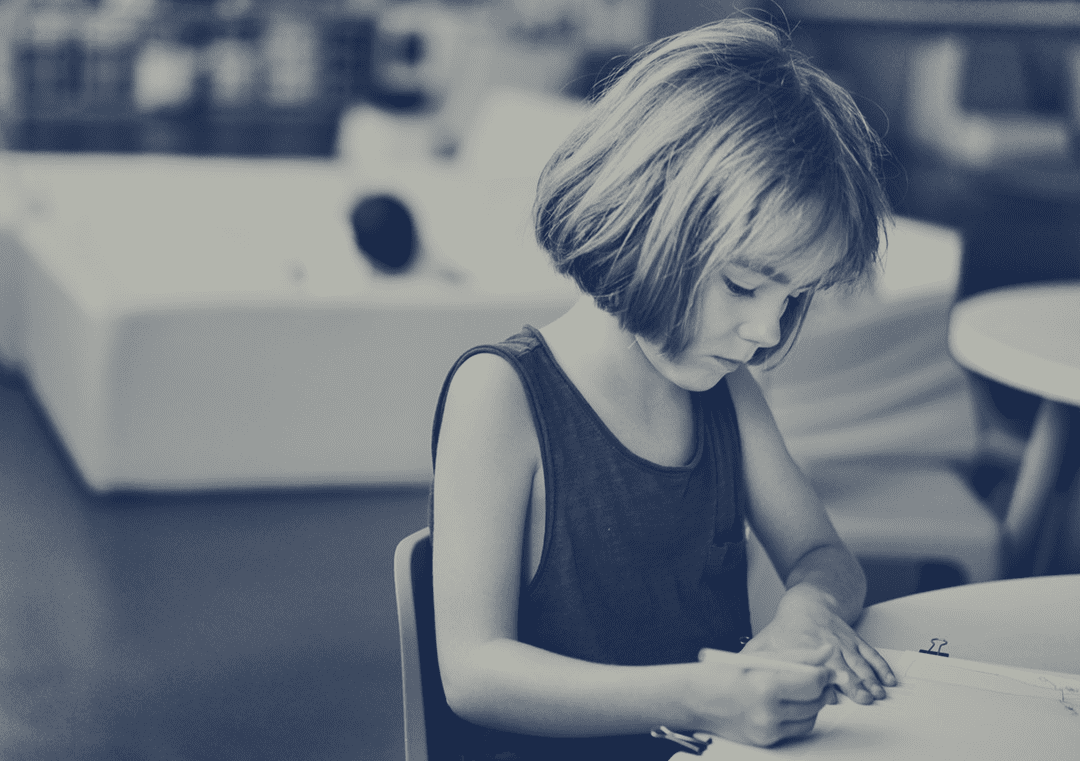 Photo of a little girl drawing