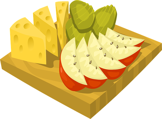 wooden cutting boar with cheese avocado and fruit slices on it showing low carb diet